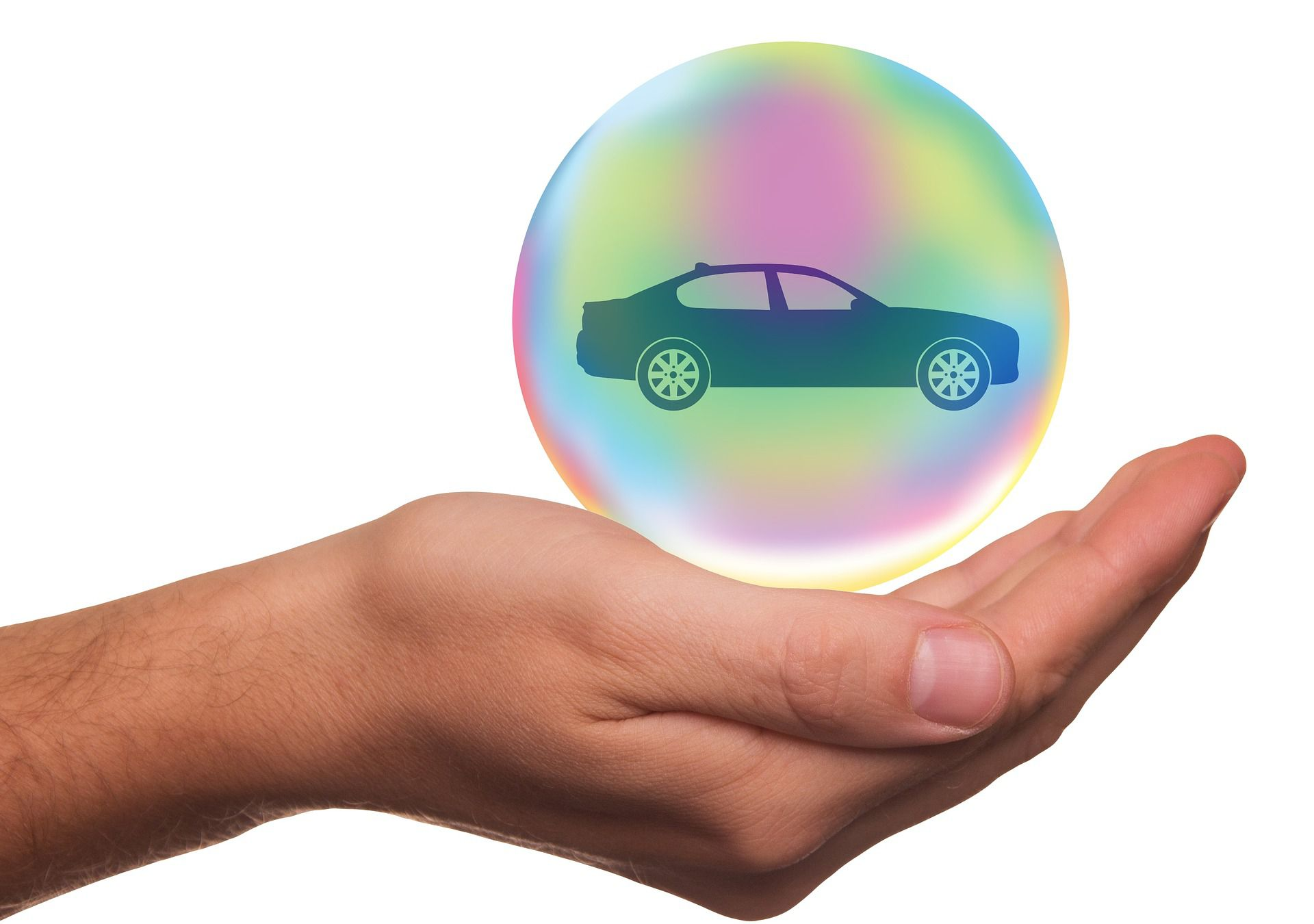 A hand holding a bubble with a car, representing car insurance.